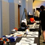 The silent auction table with sports memorabilia